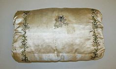 early 19th century embroidered silk satin child's muff ... photo courtesy the Metropolitian Museum of Art costume collection