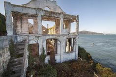 I would love to explore this abandoned warden's house attached to the most infamous prison in the U.S...