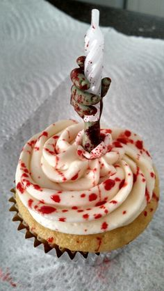 Zombie cupcake I crafted for a birthday, made with fondant. =)