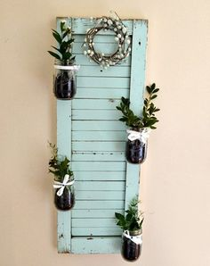 Shutter with attached Mason jars filled with greenery / Shabby & Charme