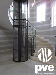 This Vacuum Lift Looks Beautiful Alongside This Spiral Staircase. #vacuum  #lift #elevator