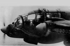 A forward machine gunner sits at his battle position in the nose of a German Heinkel He 111 bomber, while en route to England in November of 1940.