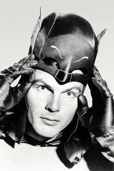 Lead actor Adam West pulls on his cowl, transforming himself from millionaire Bruce Wayne into Gotham City's caped crime-fighter Batman