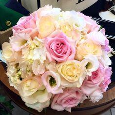 Bridal bouquet of white hydrangea, pink lisianthus, pink roses, white roses and white lisianthus.  doristhefloristt.com