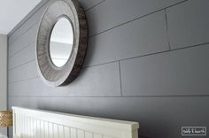 Love classic shiplap walls?? This awesome tutorial shows how easy it can be to install DIY shiplap using budget-friendly plywood underlayment.