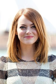 Pretty and funny, Emma has it all. With the long layered bang, this cut is chic and sophisticated. | See more celebrity lobs here: http://www.mywedding.com/articles/14-celebrity-lob-hairstyles-for-weddings/?utm_source=pinterest&utm_medium=social&utm_campaign=fashion_style