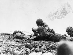 A US Army mortar team dug in on Chicago Ridge on Attu, during the recapture of the Aleutian Islands/May 1943
