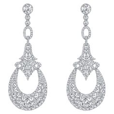 Neil Lane diamond chandelier earrings set in platinum. Ed Note: I think these would be really cool if the crescent shapes were black onyx with maybe some onyx points in the upper part for balance