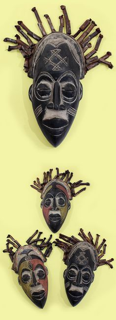 Traditional African Cameroon Chokwe Mask - Add a dramatic African piece to your décor with this original Chokwe mask.  The face has traditional scarifications on the forehead and cheeks that are meant to be marks of beautification. Flowing hair made out of rigid woven raffia rope complete this uniquely African visage. Sure to be a conversation piece when hung in your home or office. #africa #african #masks #homedecor #home #decorate #decoration #mask #carving #carved #style #bohemian