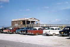 A lot of nice cars at the Isle of Palms fishing pier in the late fifties!