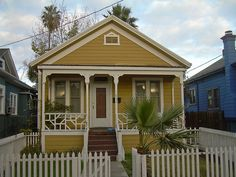 Cute mustard colored cottage.
