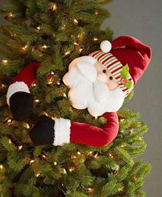 We are in love with these Christmas tree huggers! They're not the traditional Christmas tree toppers, very unique and kids love them! Elf Christmas Decorations, Elf Decorations, Christmas Tree Tops, Traditional Christmas Tree, Holiday Tree, Christmas Holidays, Christmas Wreaths, Christmas Crafts, Christmas Ornaments