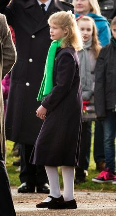 Lady Louise Windsor, who was well wrapped up against the chill in a bright green scarf as she attends Sunday church service 2014 at Sandringham.