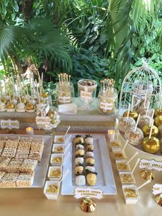 White and Gold Wedding Dessert Table. Candy Apples, Rice Krispie Treats, Chocolate Covered Strawberries, Cake Pops, Vanilla Pudding Cups