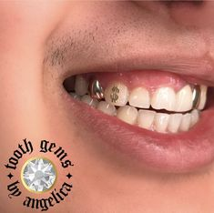 Gold dollar sign tooth gem by Halo Tattoo Collective