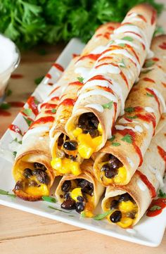 Seasoned black beans and corn smothered in cheese, rolled up in a flour tortilla, and baked to crispy perfection. These Cheesy Baked Black Bean Flautas make an easy (and tasty!) meal, snack, or appetizer! Mexican Dishes, Mexican Food Recipes, Vegetarian Recipes, Cooking Recipes, Healthy Recipes, Ovo Vegetarian, Bean Recipes, Healthy Options, Cheese Recipes