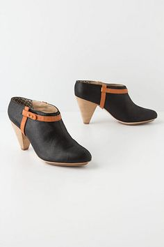 Abbreviated Booties - Anthropologie.com    I'd wear these with some skinnies and an Aztec printed wrap or poncho in the fall.