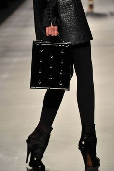love the outfit, purse, tights, and shoes.  love it all.  Fendi.