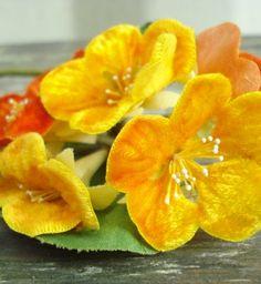 Velvet nasturtiums. Brain is semi refusing to accept these exist, Gorgeous! Vintage velvet millinery flowers