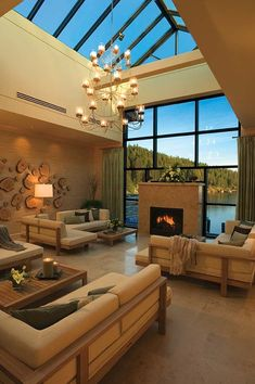 Obsessed with the windows/view/fireplace/chandelier.....would have chosen different furniture