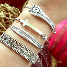 Set of 4 Bangles. PRICE FIRM Silver plated bangles..set of 4. Absolutely beautiful and stunning. No affiliation whatsoever with Alex and Ani. They have small charms but not Alex and Ani symbols. Boutique brand!                                                           ❤️❤️❤️Price Is Firm❤️❤️❤️ Boutique Jewelry Bracelets