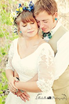 Outdoor wedding, bride and groom pose, hug from behind, embrace, wedding portraits photo by Lillabella Photography