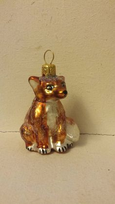 Sweet little Fox Cub glass ornament for your Christmas Tree. Hand Made in Poland from Blown Glass this little chap measures approx. 2.75 inches.