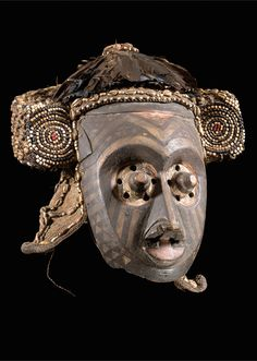 Africa   Mask from the Bushoong Kuba people of DR Congo   Wood, raffia, glass beads and cowrie shells