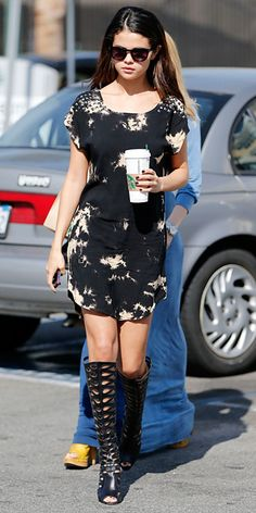 Selena Gomez Tie-dye shift dress with knee-high Brian Atwood gladiator boots.