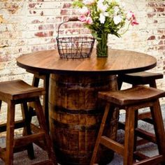 Barrel table ....but would have to have it so my knees didn't bump into the barrel, legs must fit under the table