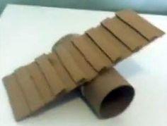 Cardboard Roll Hamster Seesaw - PetDIYs.com