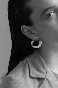 Irregular disk earrings by Luiny. Hand carved from wax. Brass with Silver post Luiny loves Mama Earth, all pieces are made with recycled metals Made in NYC