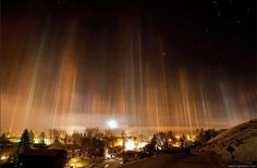 Light pillars, An Incredible Optical Phenomenon !!!    Sometimes during very cold weather, vertical columns of light beaming directly upwards are visible. These are called light pillars and are created by the reflection of light from ice crystals with near horizontal parallel planar surfaces. The light can come from the Sun in which case the phenomenon is called a sun pillar or solar pillar. Light pillars are typically seen in polar regions.