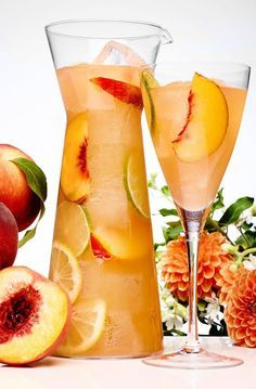 You can never go wrong with a chilled glass of sangria. The fruity wine can really quench one's thirst on a hot summer day. We love sangria because it can Party Drinks, Cocktail Drinks, Fun Drinks, Cocktail Recipes, Alcoholic Drinks, Beverages, Mixed Drinks, Peach Sangria Recipes, Brunch Drinks