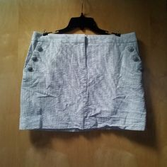 "J. Crew Striped Mini Skirt with Button Pockets J. Crew, size 12, in excellent condition! Perfect spring and summer skirt! Gray and white vertical stripes with three button details on each pocket. Zipper and tab button in front. Also has back pockets. Only flaw is minor wear/patina on buttons. 17"" waist and 15"" length. Please ask any and all questions before purchasing. No trades. Made a reasonable offer. Thanks! J. Crew Skirts Mini"