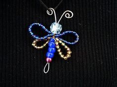 DIY BUTTERFLY OR DRAGONFLY, make this cute charm or pendant with wire and beads.  Follow along with this video! More jewelry making in my  JEWELRY PLAYLIST:   http://www.youtube.com/playlist?list=PL4F3391B2FE97D722=view_all      GET YARN AND HOOKS HERE: http://www.ashton11.com/supplies  Get My FREE Crochet Stitches Ebook:    http://hectanoogapa...