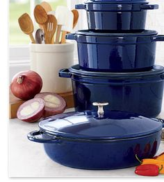 Staub cookware, I just got my first piece, the large 9qt. dutch oven in the back on the bottom.  I LOVE this!