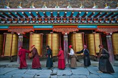 EDITOR'S PIC OF THE DAY Photo: MICHAEL YAMASHITA Segyagu, the faithful doing Kora and turning prayer wheels at this meditation center with it's huge mani stone monument nearby Lhagong monastery.