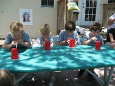 Race to blow cup across the table with only a straw