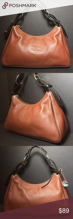 Dooney & Bourke 1975 Brown Leather Hobo Handbag Dooney & Bourke 1975 Brown Leather Hobo Handbag There Is Some Discoloration On The Trim As Pictured. Dooney & Bourke Bags Hobos