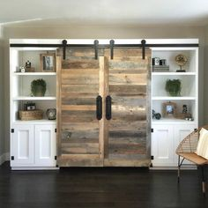Barn wood doors on entertainment center open bookshelves for family room.
