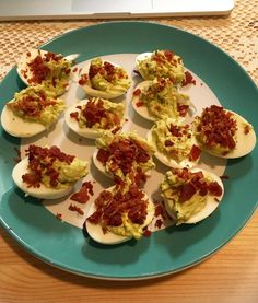 Avocado deviled eggs topped with crumbled bacon  #avocado #deviledeggs #keto #ketosis #ketogains #foodporn #lchf #lowcarb by ra.d.kendrick