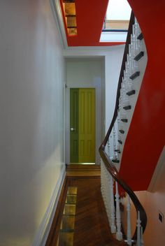 Ft Greene brownstone by Mesh Architects, owner is an artist, red defines the vertical circulation, colour defines spaces