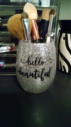 Make up brush holder. Glass with silver glitter and vinyl saying $6