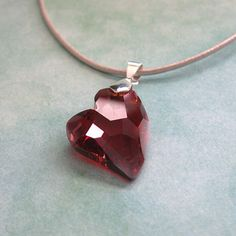 1.5 inch Swarovski crystal heart pendand on leather cord. http://www.etsy.com/listing/91109459/red-magma-swarovski-crystal-heart-on
