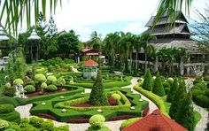 Suan Nooch Nong Garden in Pattaya, Thailand ----- This garden was developed in the year It has villas and restaurants along with pools. This garden is a house for plants and ornamental flowers. One of the major attractions of this garden is the cultu Topiary Garden, Garden Pots, Landscape Design, Garden Design, Chateau Versailles, Gardens Of The World, Beautiful Flowers Pictures, Most Beautiful Gardens, Magical Gardens