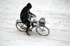 It's a challenge but it can be done. Biking in the snow in Copenhagen.