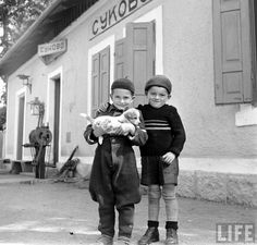 Two Serbian children holding a puppy at Sukovo train station, 1950