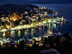 Symi Harbour by night.  Photo by Jordan Blakesley