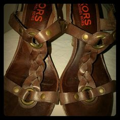 Kors MK brown braided leather strappy sandal heels Perfect for summer. Michael kors higher end label. Brown braided leather accent. Cork heel.  Buckles around ankle.  Peep toe sandal.  Leather soles. Made in Brazil. No condition issues. KORS Michael Kors Shoes Heels